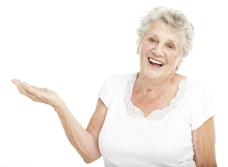 elder care: portrait of senior woman gesturing offer with hand over white background Stock Photo