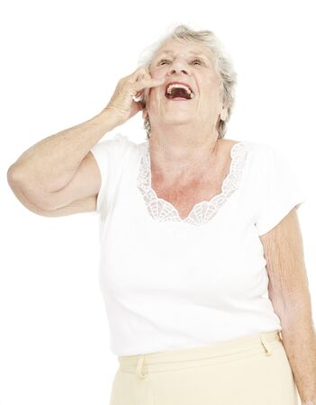 portrait of senior woman laughing and  gesturing call over white background photo