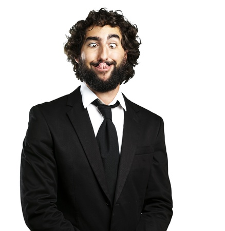 funny face: portrait of young business man showing the tongue over white background Stock Photo