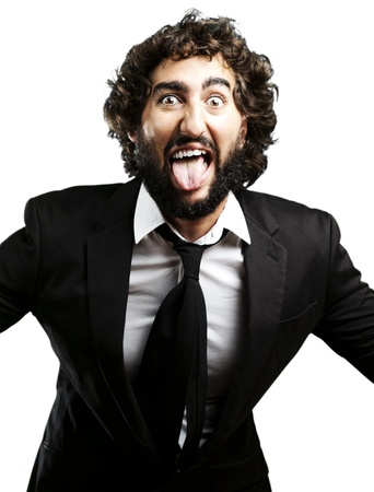 portrait of young man joking and showing the tongue over white background photo