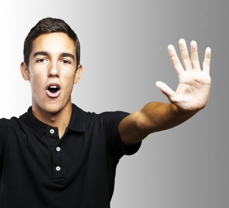 man doing a stop gesture Stock Photo - 13464310