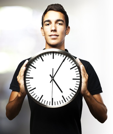 man holding clock Stock Photo - 13486132