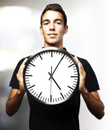 man holding clock Stock Photo - 13486132