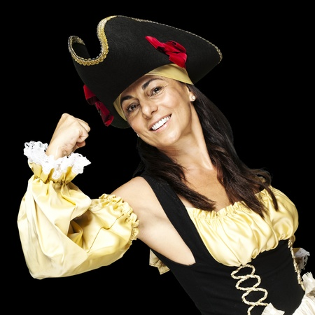 portrait of pirate woman gesturing against a black background photo
