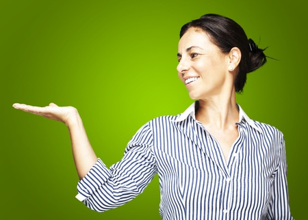 portrat of a middle aged woman holding gesture over green photo