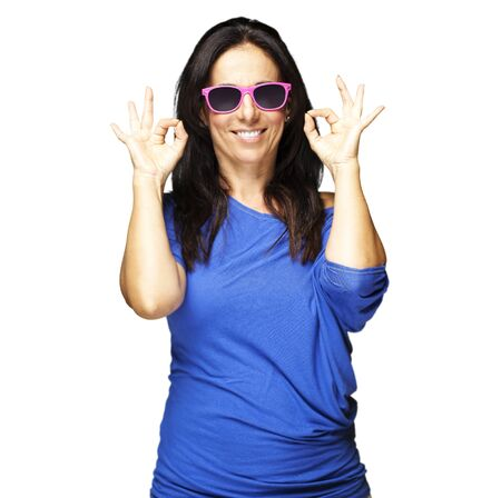 portrait of woman gesturing good against a white background Stock Photo - 11497046