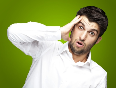 portrait of young man surprised against a green background Stock Photo - 11507605