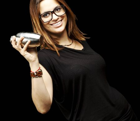 portrait of young woman shaking cocktail over black background Stock Photo - 11507608