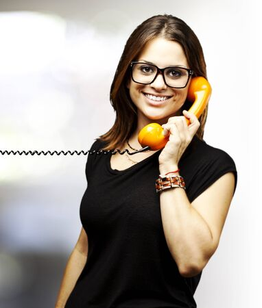 portrait of woman talking using vintage telephone indoor Stock Photo - 11507627