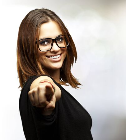 portrait of young woman pointing with finger indoor Stock Photo - 11507604