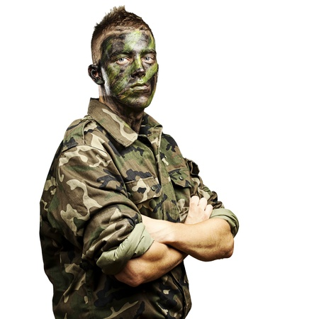 paint gun: portrait of young soldier with jungle camouflage paint on a white background