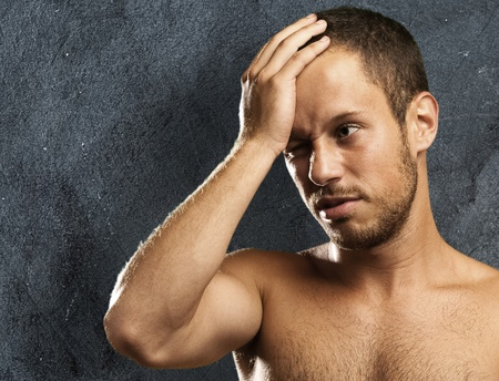 regret: regret young man on a vintage background Stock Photo