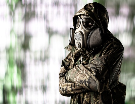 portrait of soldier wearing gas mask waiting against a abstract background photo