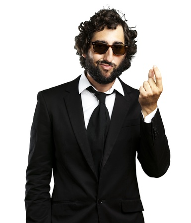 portrait of young business man gesturing money over white background photo