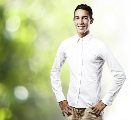 portrait of young man smiling with shirt against a plants background Stock Photo - 11954889
