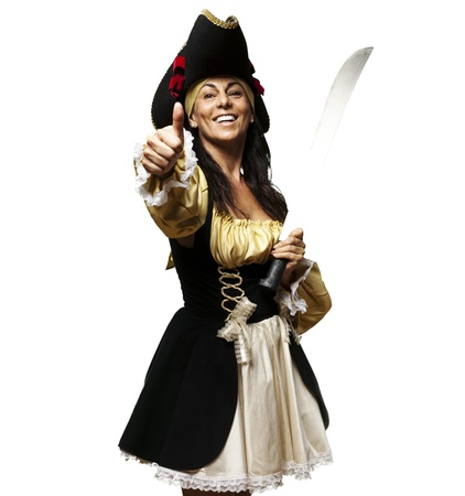 portrait of pirate woman holding a sword and gesturing ok against a white background