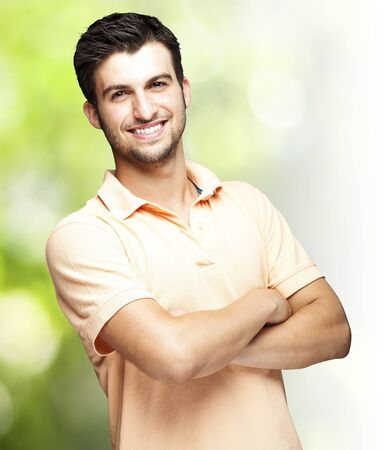portrait of a happy young man smiling against a nature background Stock Photo - 11507821