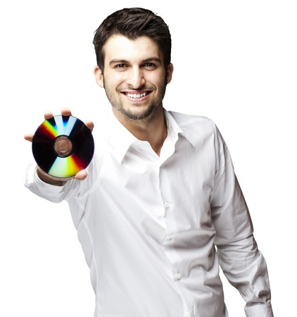 portrait of a handsome young man holding cd against a white background photo