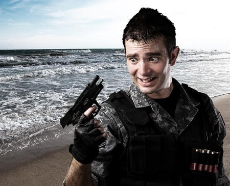 portrait of young soldier reload fail at the beach photo