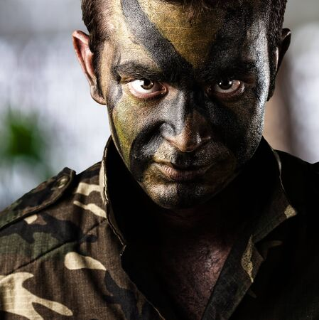 Portrait Of Young Soldier Face Over Abstract Background Stock Photo