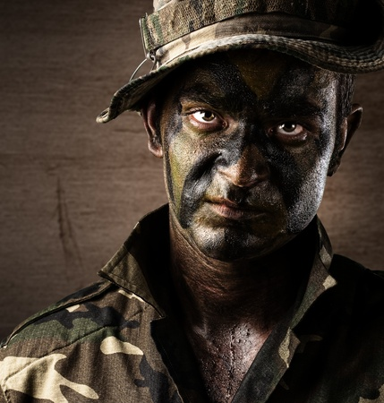 soldier with rifle: soldiers face Stock Photo
