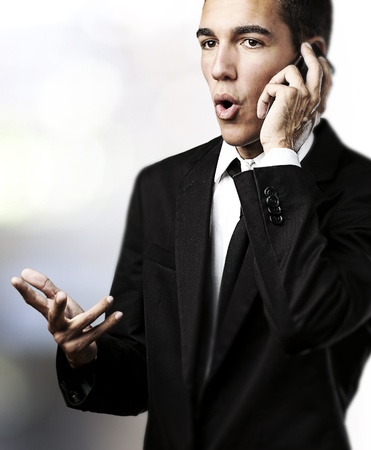 portrait of business man talking on mobile indoor photo
