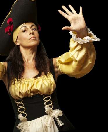portrait of pirate woman gesturing stop against a black background photo