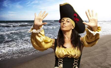 portrait of pirate woman gesturing stop in the beach photo
