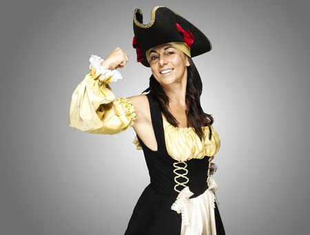 portrait of pirate woman gesturing against a grey background photo
