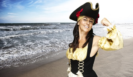 portrait of pirate woman gesturing at the beach photo