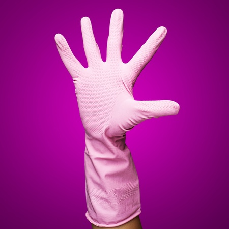 pink rubber gloves against a pink background photo