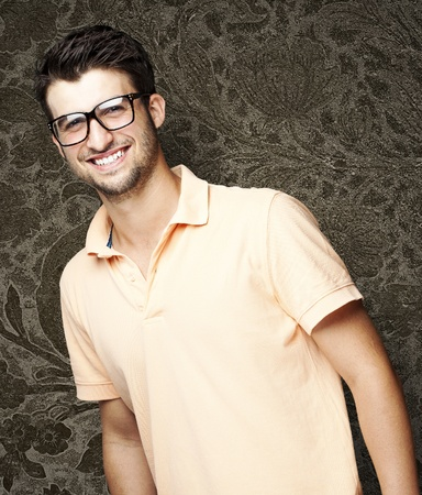 smart man: portrait of a handsome happy man against a vintage wall Stock Photo