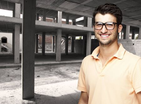 portrait of a young man smiling at a unfinished building Stock Photo - 12105178