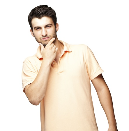thinking man: portrait of young man thinking against a white background
