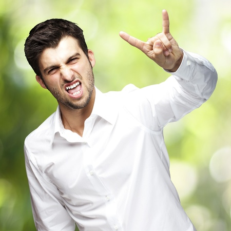man doing rock gesture Stock Photo - 13486137