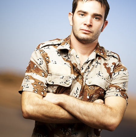 portrait of a serious young soldier standing against a abstract background Stock Photo - 13156072