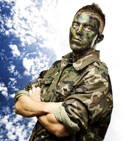 portrait of young soldier against a cloudy sky background Stock Photo - 13156199