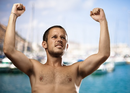 winner young man against a harbour background photo