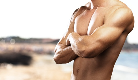 strong torso of young man against a sea background photo