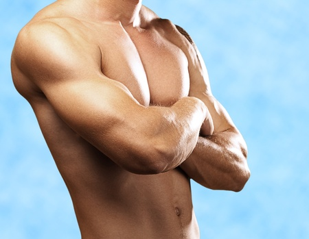strong young man with a pool as a background photo