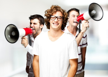 young employees group shouting with megaphones against a abstract background photo