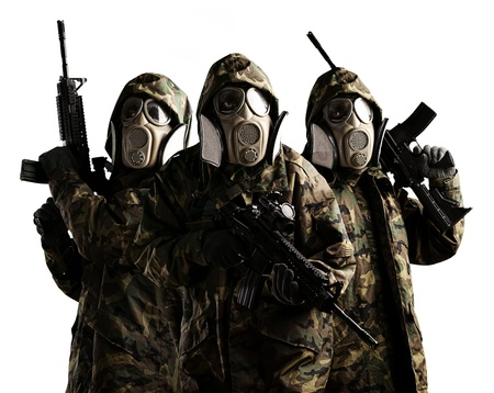 Tree armed soldiers with gas mask and rifles against a white background photo