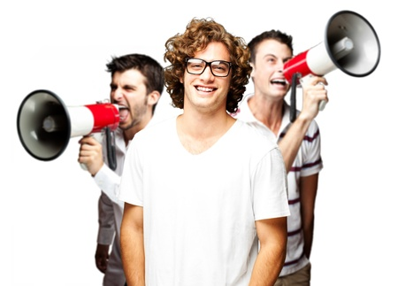 young employees group shouting with megaphones against a white background Stock Photo - 13156092