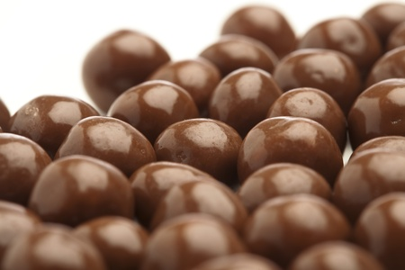praline: cereal chocolate balls on a white background Stock Photo