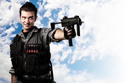 man holding gun: soldier aiming with his gun Stock Photo