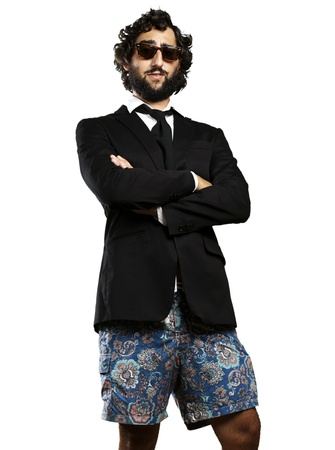 portrait of young business man wearing swimsuit against a white background photo