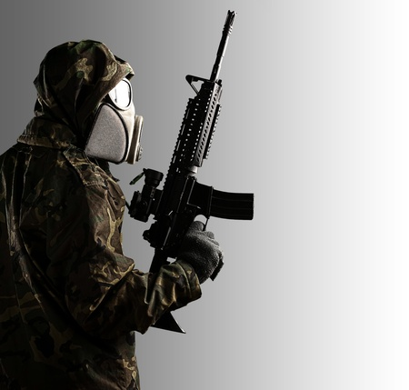 portrait of soldier with mask and rifle against a grey background Stock Photo - 12377902