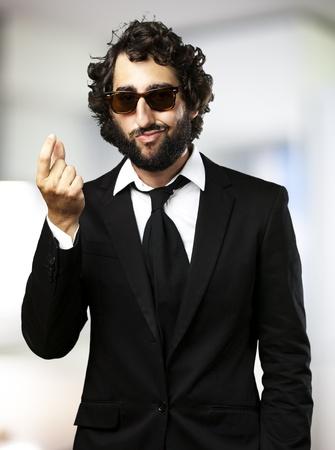 portrait of young business man gesturing money indoor Stock Photo - 12656127