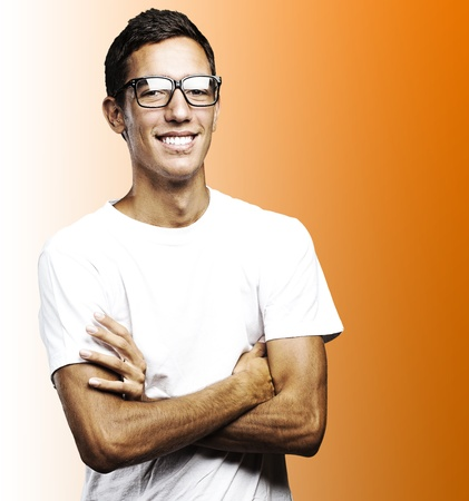 portrait of young man smiling with glasses against a purple background photo