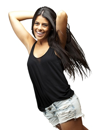 latin girls: portrait of a pretty young woman posing against a white background Stock Photo